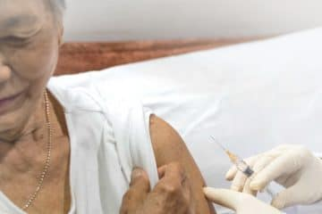 Old woman taking shringle vaccine